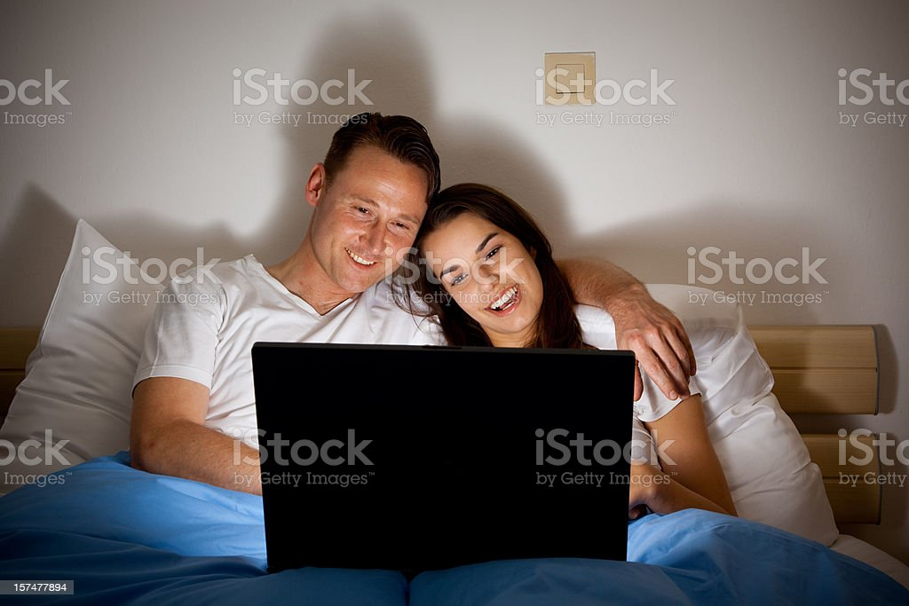 happy couple watching a video stock photo