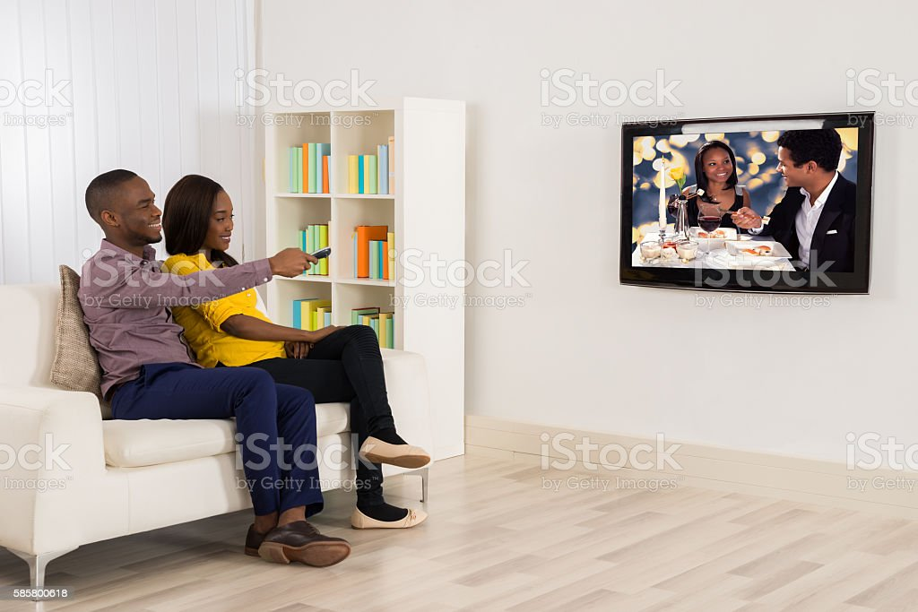 Happy Couple Watching Television stock photo