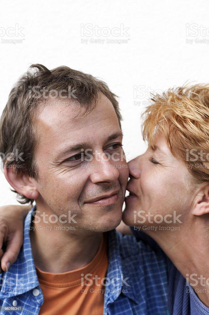 Happy couple whispering royalty-free stock photo