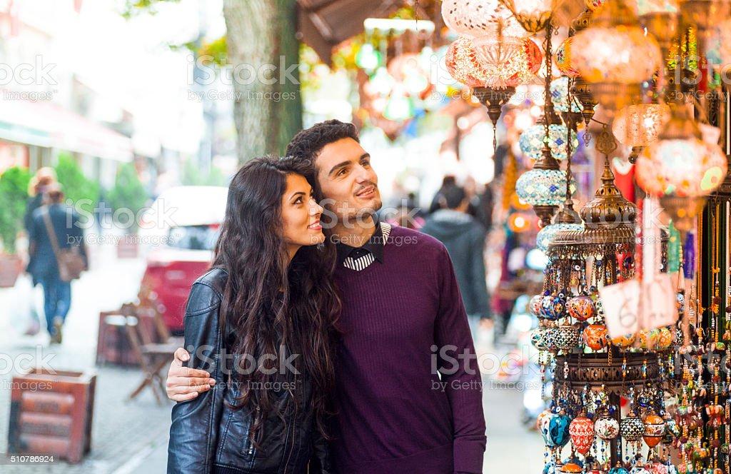 Happy Couple Window Shopping in a Street Bazaar stock photo