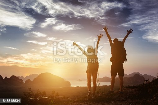 istock Happy couple winner success concept mountains 648318834