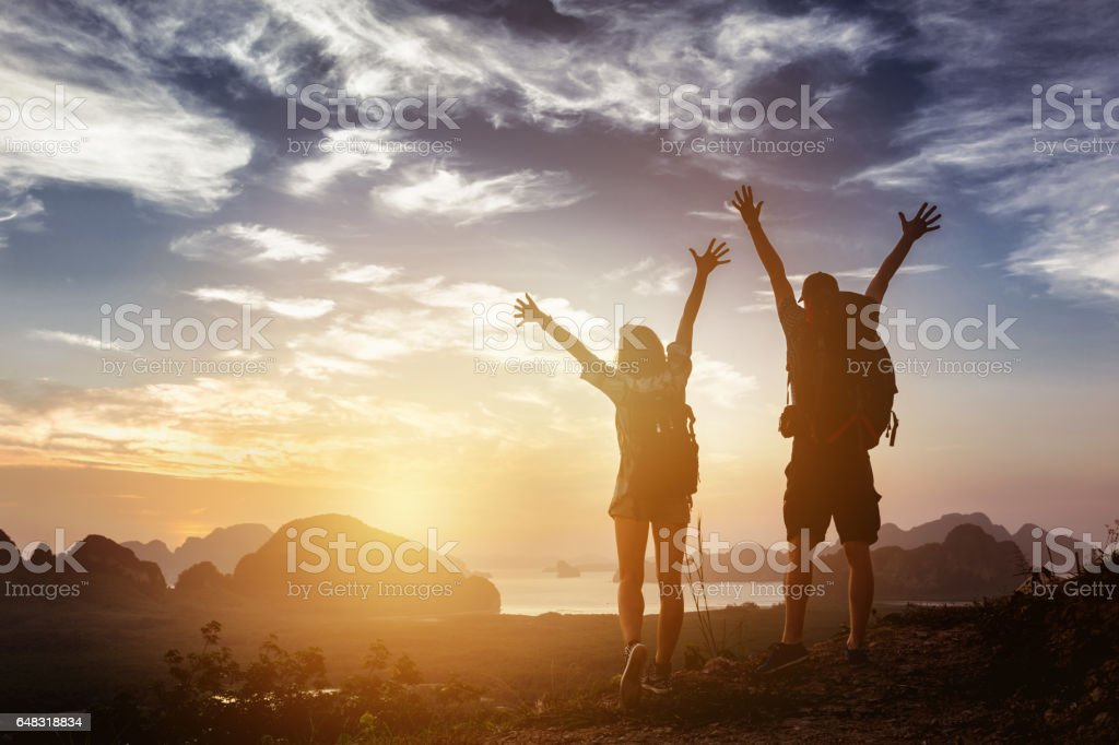 Happy couple winner success concept mountains stock photo