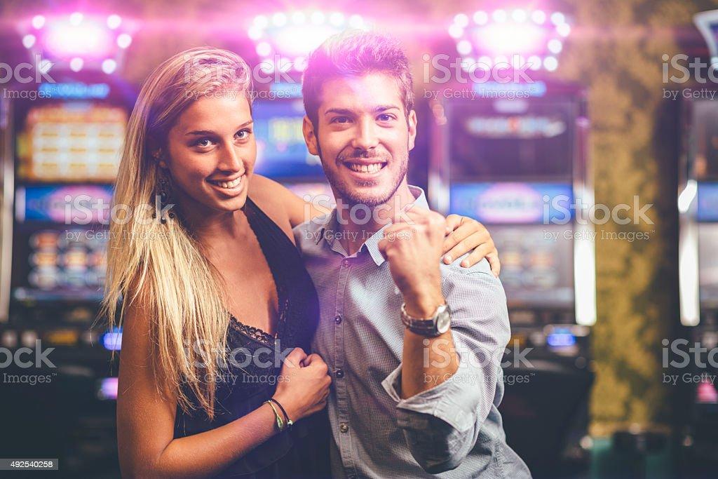 Happy Couple winning at Casino stock photo