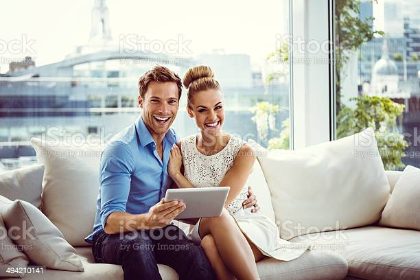 Happy Couple With A Digital Tablet Stock Photo - Download Image Now