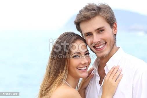 istock Happy couple with a white smile looking at camera 523036491