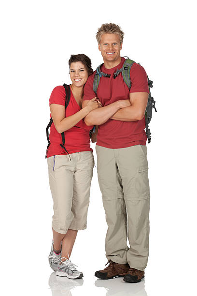 glückliches paar mit rucksäcken - denim caprihosen stock-fotos und bilder