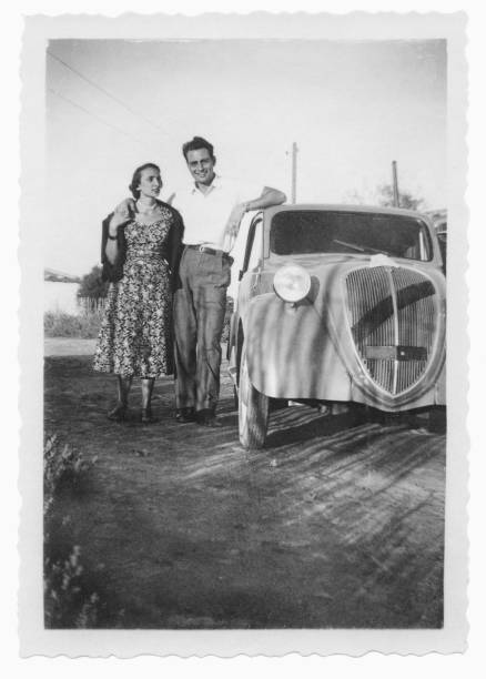 Happy Couple With Car In 1950 Stock Photo
