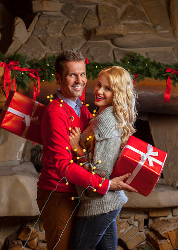 Happy Couple With Christmas Gift Stock Photo - Download Image Now