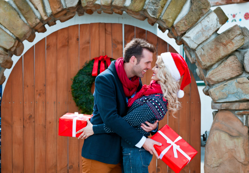 Happy Couple With Christmas Gifts Stock Photo - Download Image Now