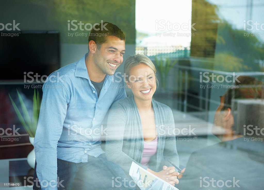 Happy couple with consultant royalty-free stock photo