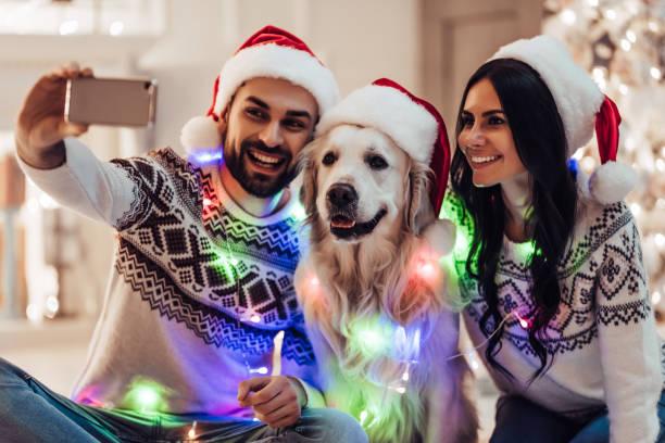 Happy couple with dog labrador retriever waiting for the new year picture id879631632?b=1&k=6&m=879631632&s=612x612&w=0&h=yknu1oyst2hltvpwkwnhpyjjlhh8twc rj8 xv9zmo8=