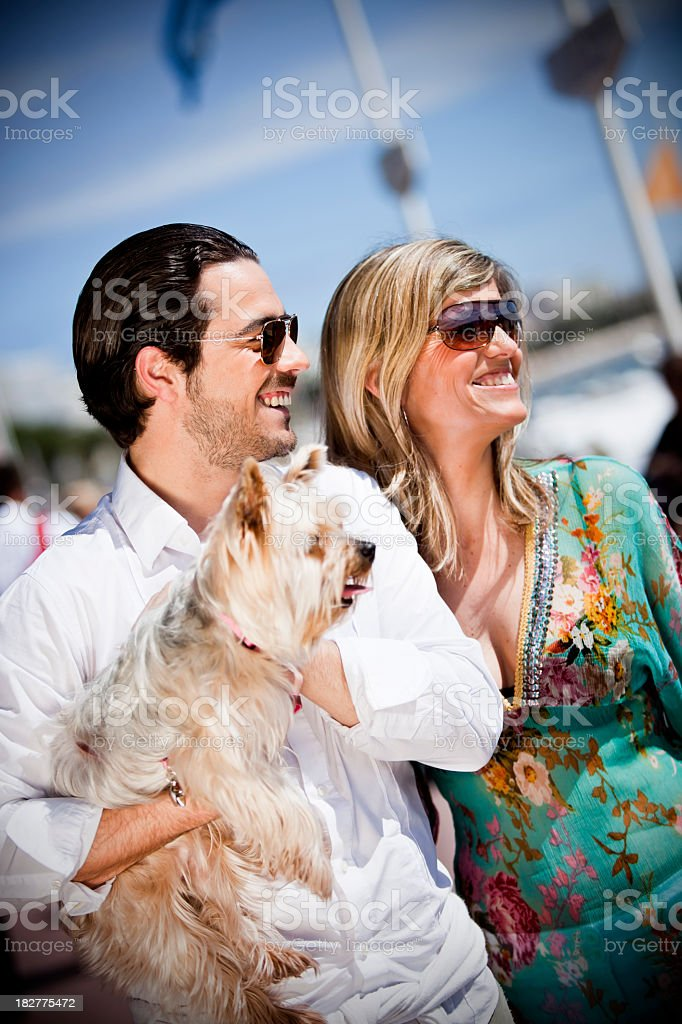 Happy couple with dog royalty-free stock photo