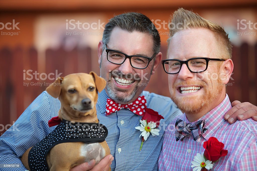 Happy Couple with Dog stock photo