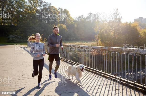 Happy couple with dog running outdoors picture id698840738?b=1&k=6&m=698840738&s=612x612&h=zdiyrhzkgowmqi0v022ee3crcnbqurcodfzpmrvhcms=