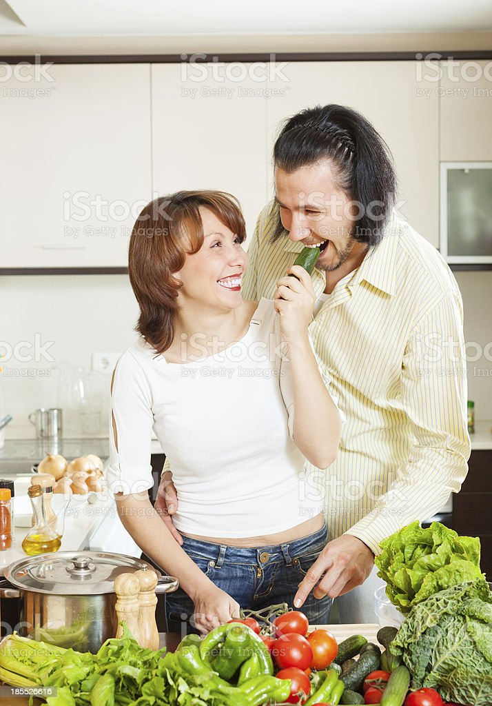 happy couple with fresh vegetables royalty-free stock photo