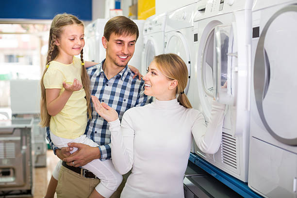 happy couple with girl in hypermarket - happy person buy appliances stock photos and pictures