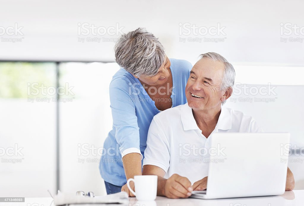 Happy couple with laptop at home royalty-free stock photo
