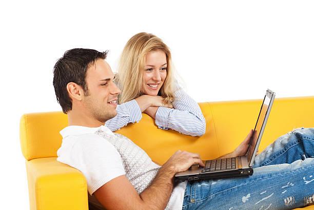 Happy couple with laptop computer stock photo