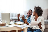 istock Happy couple with laptop spending time together at home. 1285914519
