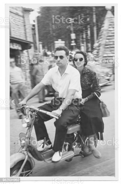 Happy couple with motorcycle in 1950 picture id942534952?b=1&k=6&m=942534952&s=612x612&h=ninlnop8b2n0pklxmhqz9mxyeifdzris5nyjw4ekh78=