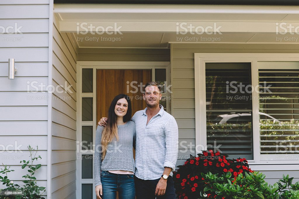 happy couple with new home stock photo