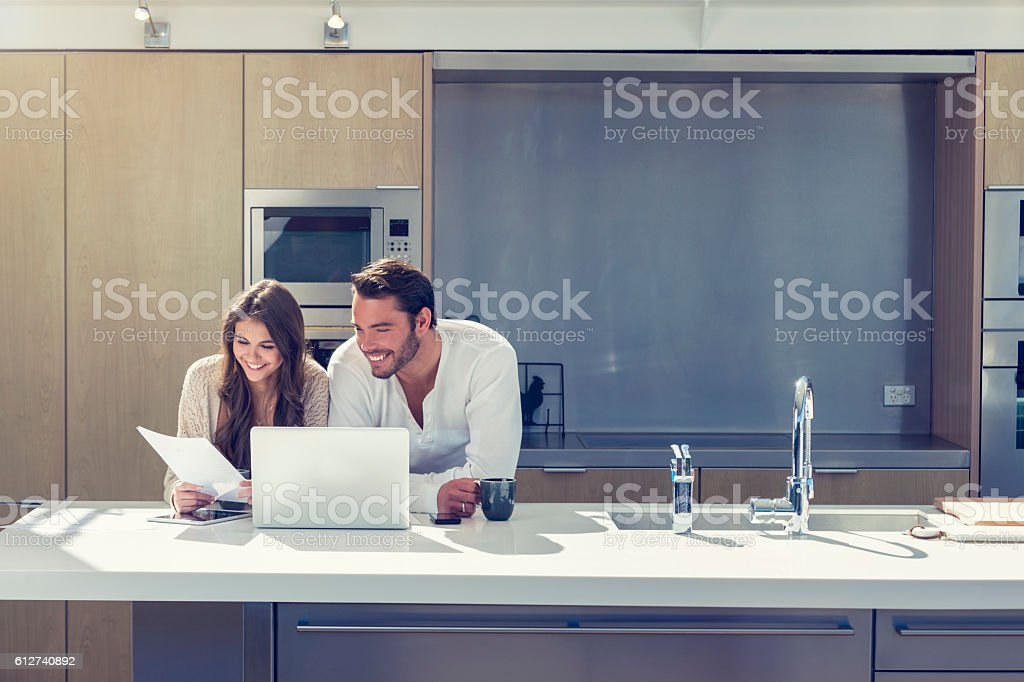Happy couple with paperwork. – Foto