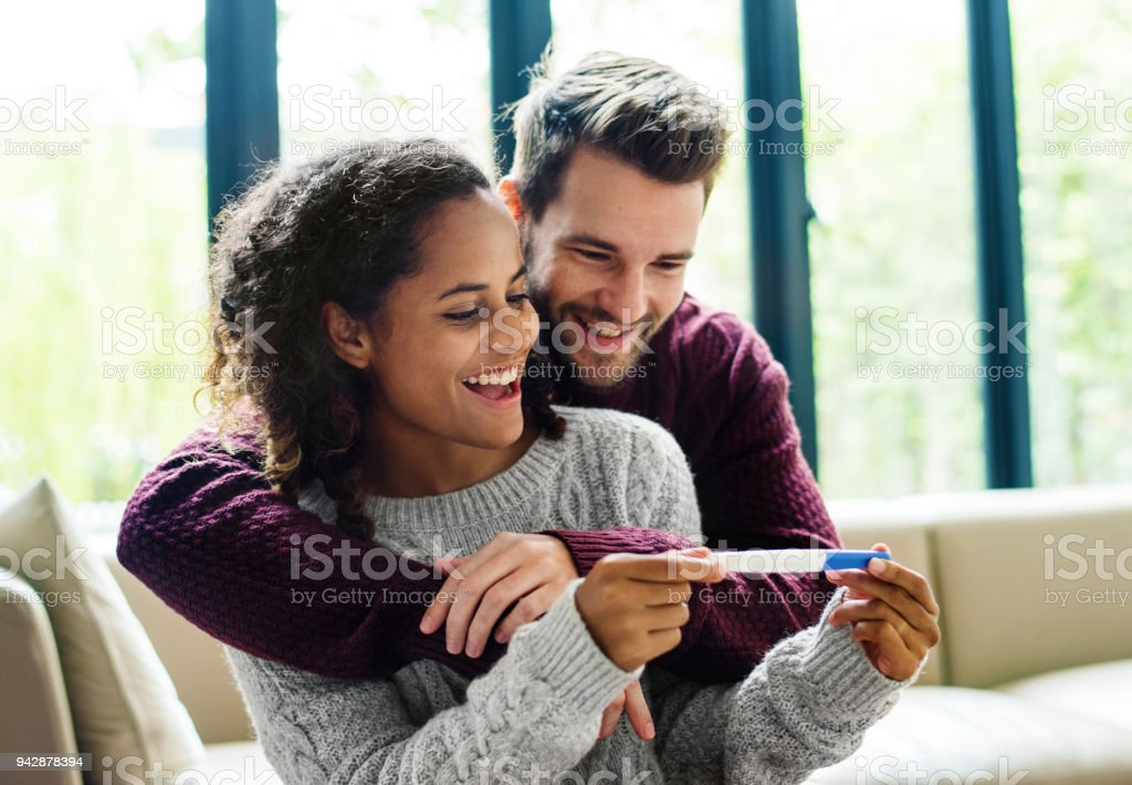 Happy couple with pregnancy news royalty-free stock photo