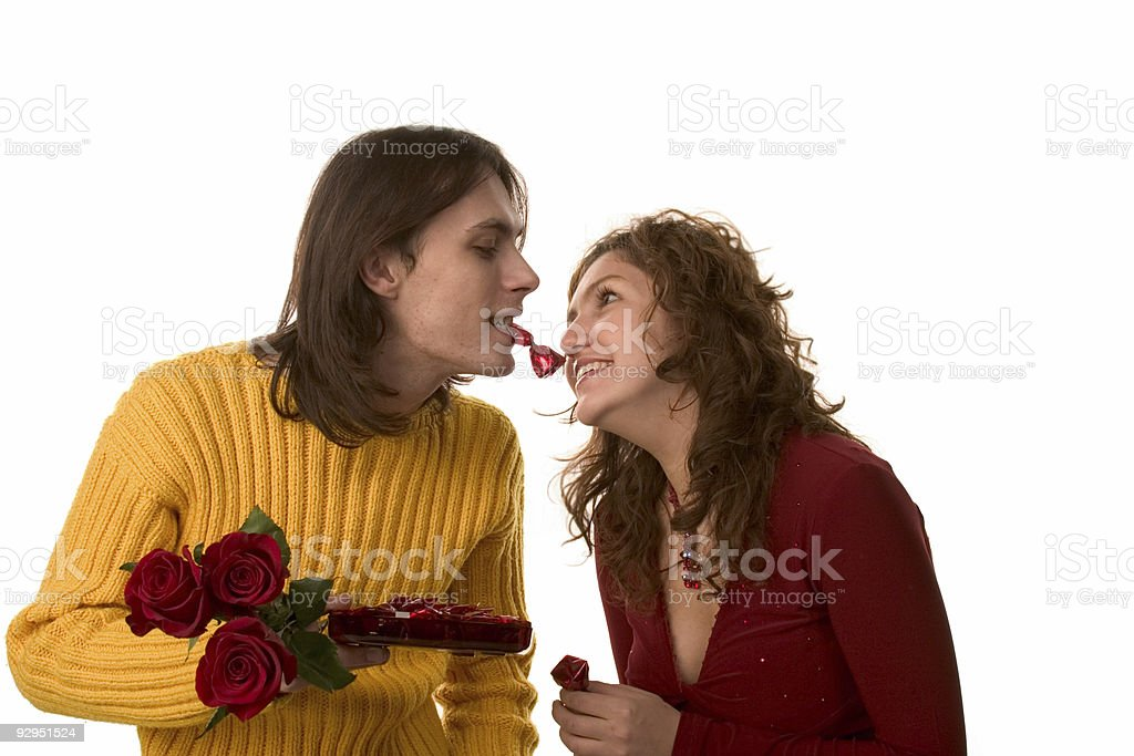 happy couple with roses and candy stock photo