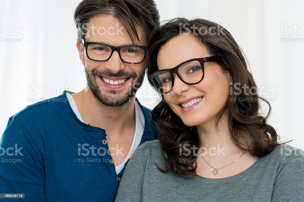 Happy couple with specs stock photo