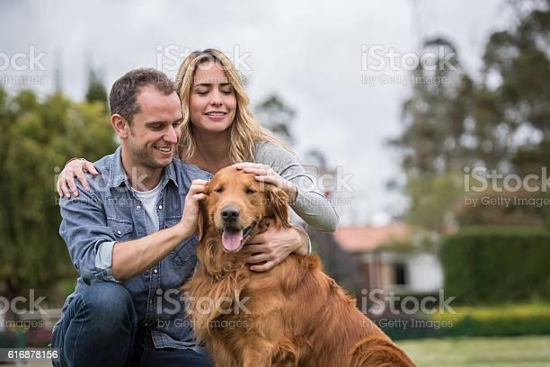 Happy couple with their dog picture id616878156?b=1&k=6&m=616878156&s=612x612&h=qvl immumlg8mekerhtnz3gubrwsouzaaa8zy8dt6gw=