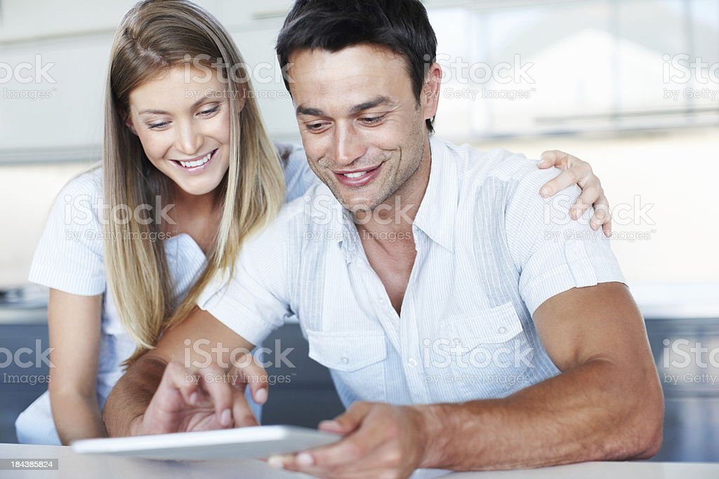 Happy couple working on digital tablet royalty-free stock photo