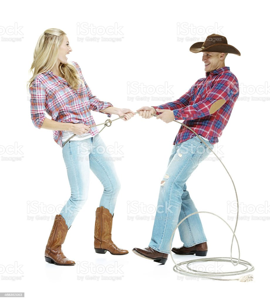 Happy cowboy couple playing with lasso royalty-free stock photo