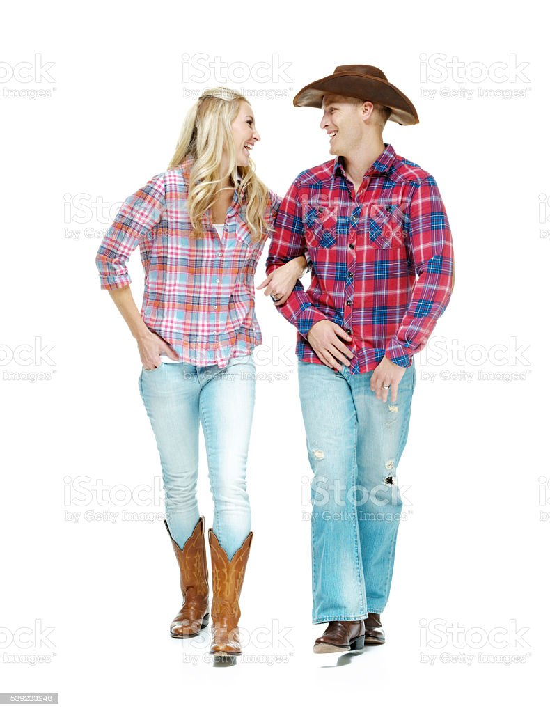 Happy cowboy couple walking together royalty-free stock photo