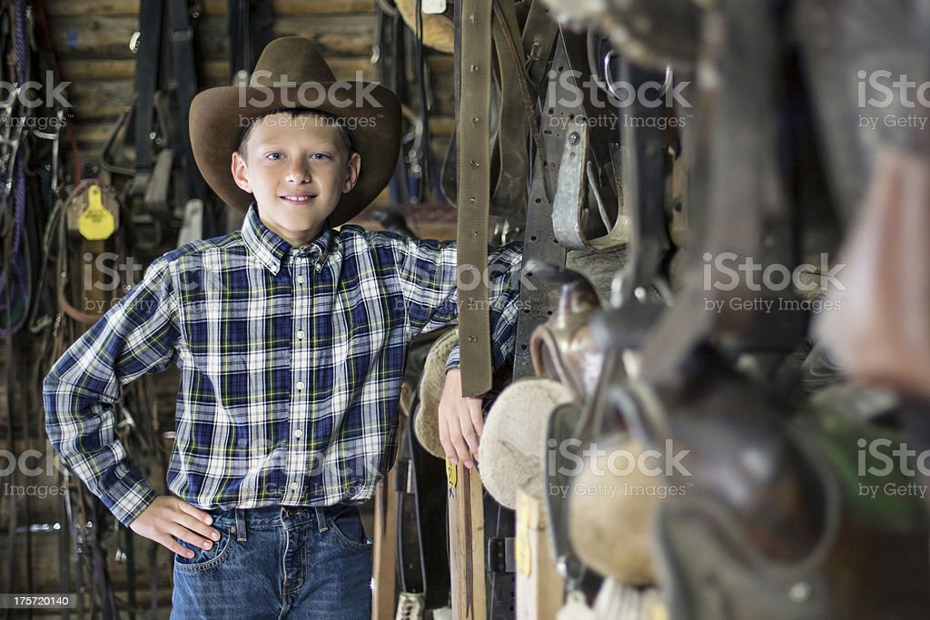 Happy cowboy in the barn royalty-free stock photo