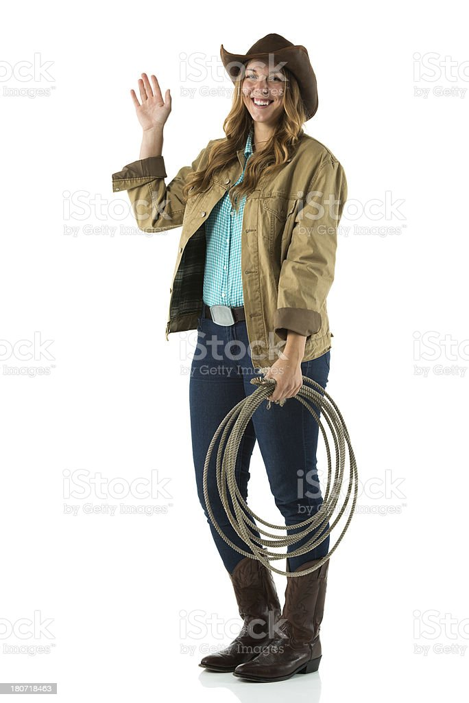 Happy cowgirl waving hands royalty-free stock photo