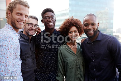 istock Happy creative business colleagues smiling to camera outdoors, waist up, close up 1146473146