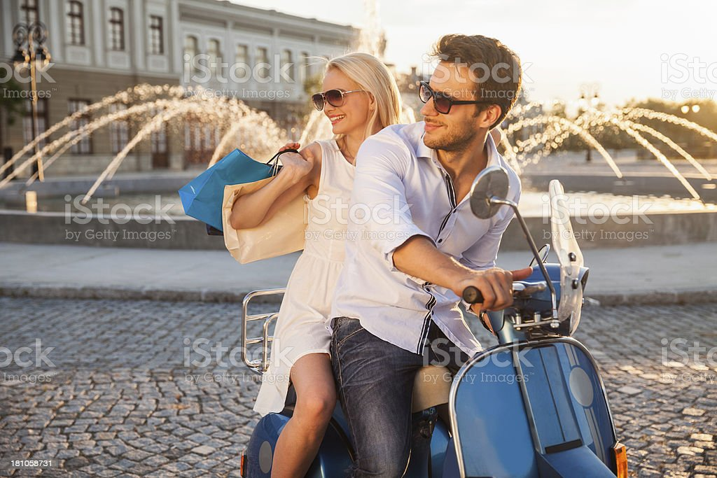Happy cuople on scooter royalty-free stock photo