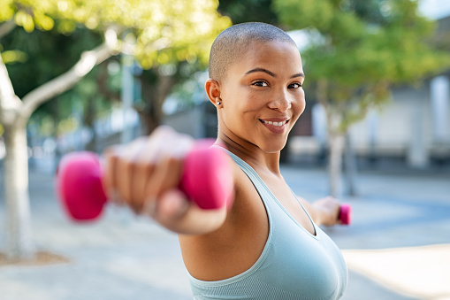 istock Happy curvy woman exercising 1141392937
