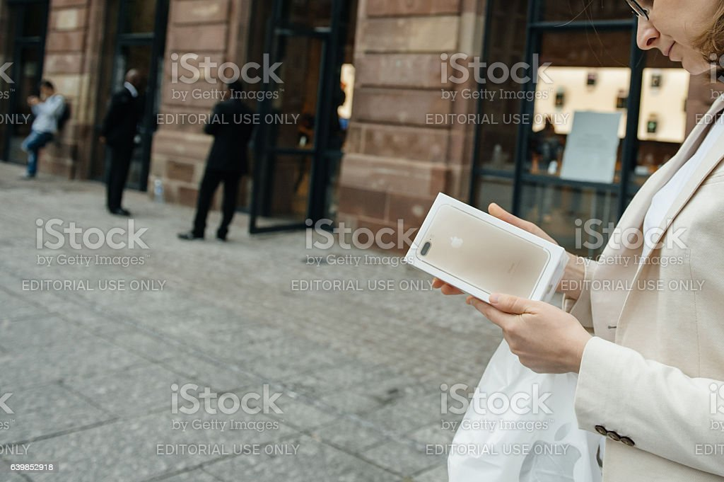 Happy customer after purchasing the new iPhone 7 plus stock photo
