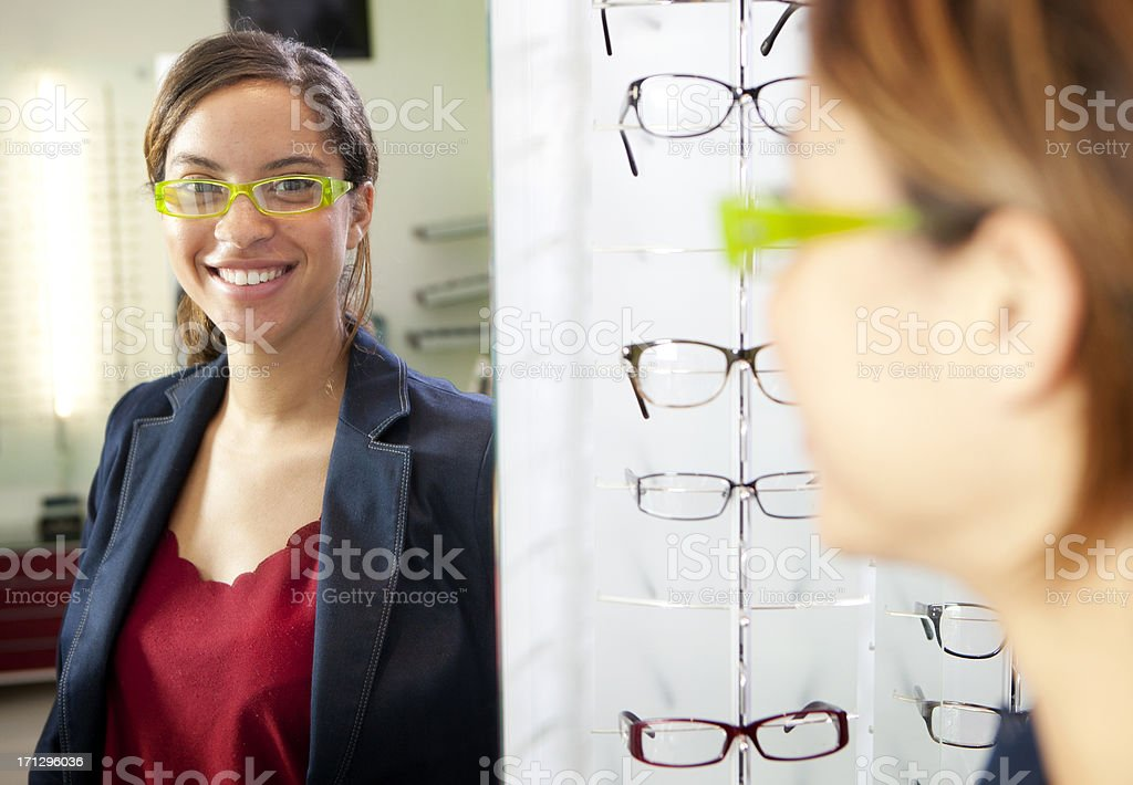 Happy customer at optician's store royalty-free stock photo