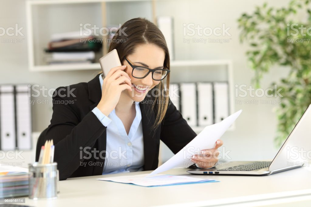 Happy customer calling support service at office royalty-free stock photo