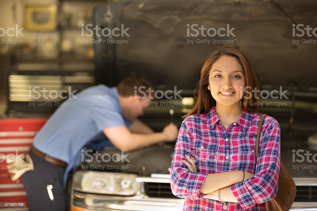 Happy customer satisfied with auto mechanic's great service. stock photo