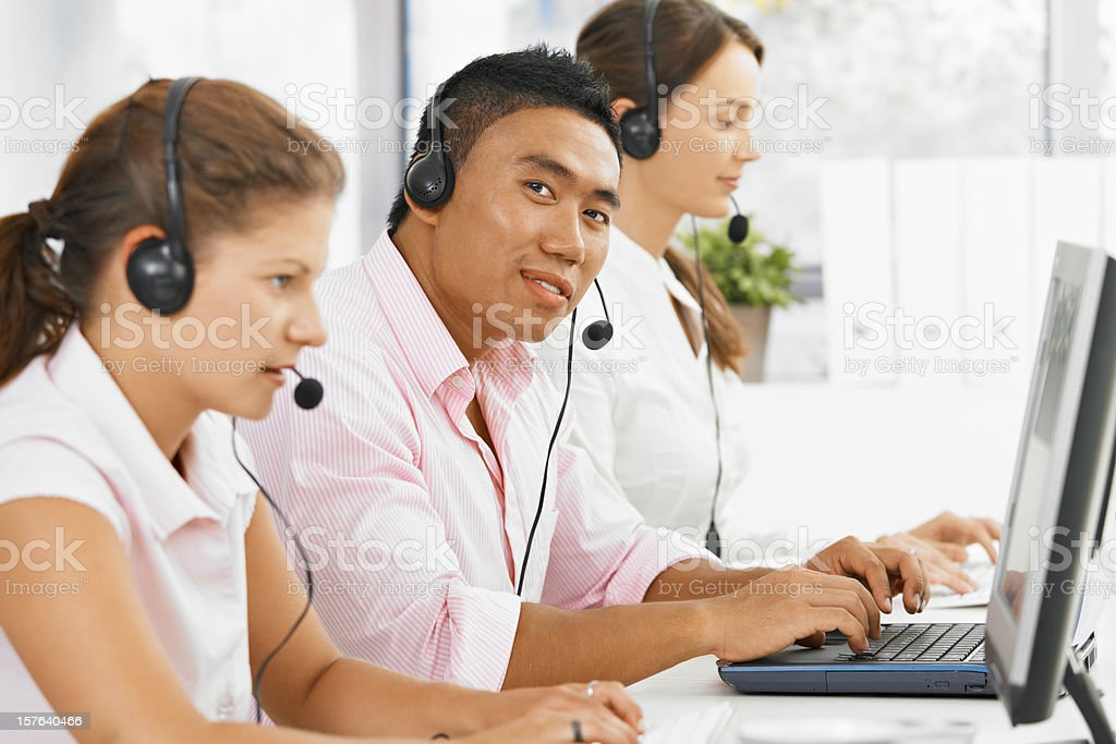 Happy customer service team working royalty-free stock photo