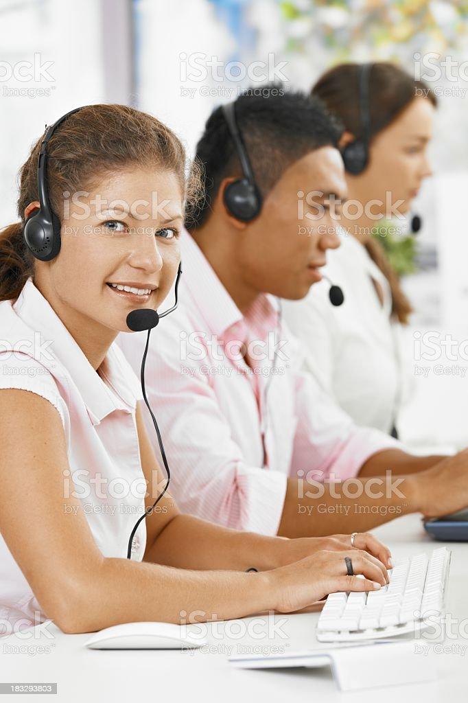 Happy customer service team working royalty-free stock photo
