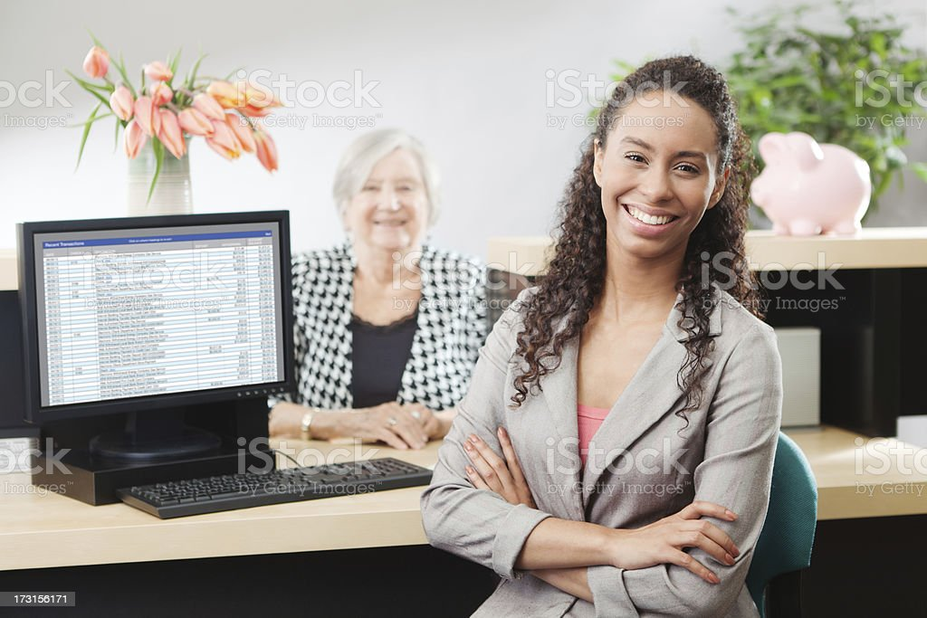 Happy Customer with Cash Money in Bank Counter Window stock photo