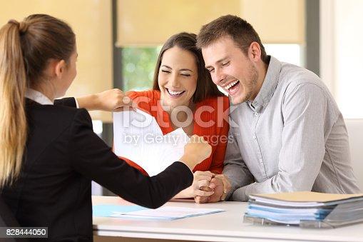 istock Happy customers ending contract and breaking it 828444050