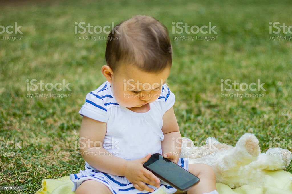 Happy Cute Baby Girl Is Playing With Smart Mobile Phone Stock Photo Download Image Now Istock