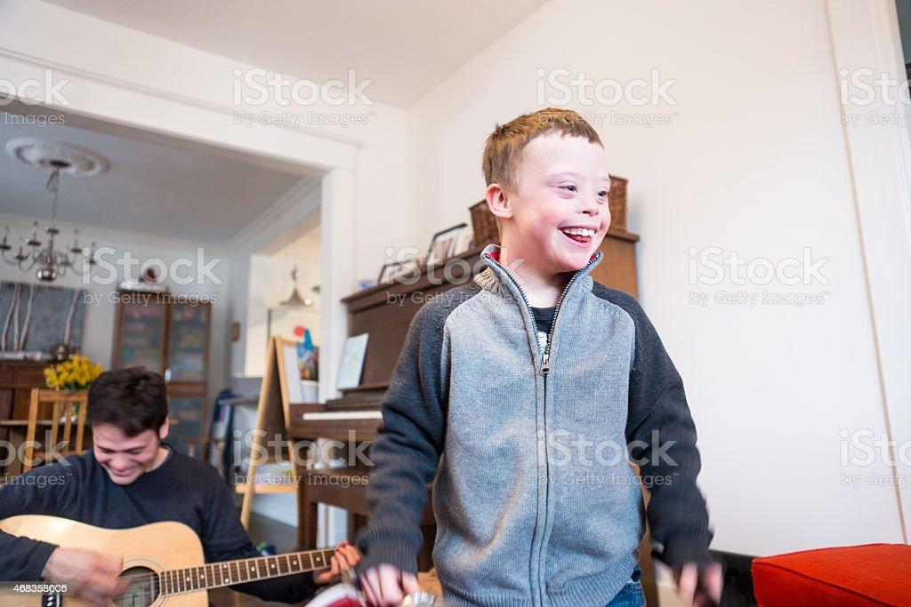 Happy, cute boy with Down Syndrome dancing. royalty-free stock photo