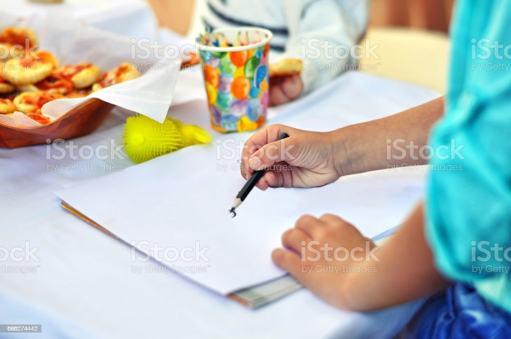 Happy cute child drawing .Creativity and education concept. stock photo
