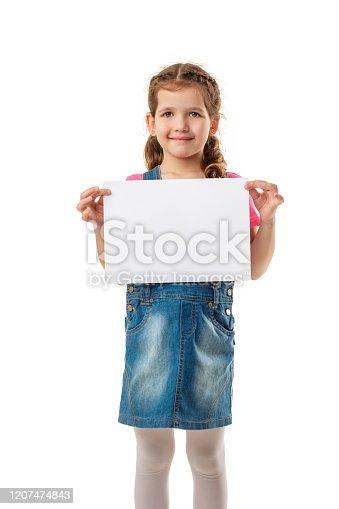 519837800 istock photo Happy cute child girl holding empty blank 1207474843